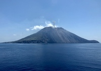 Stromboli had erupted the day before we cruised by it, and it was still smo