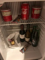 Mini bar on arrival.Missing $110.00 in goods. piece of cake with fork in it