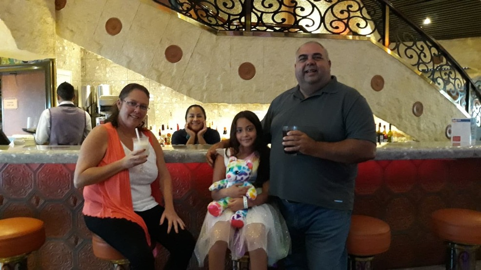 My family and I enjoying a cool drink.