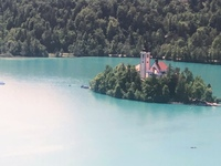 Photo of the church on the island in the middle of Lake Bled, take from the