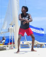 On of the crew on the Jolly Roger dancing for us on the catamaran