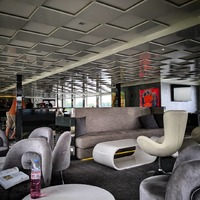The U Lounge, the one lounge open during our cruise. The rooftop Ice Bar wa