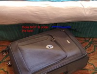 Suitcase will not slide under the bed, which is actually two cots pushed to