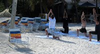 Yoga on the beach at Castaway Cay.