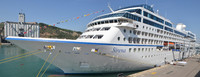 Sirena, port side. Cabin 6004 is the circular porthole second from the fron