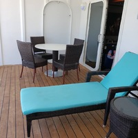 Deck with two lounge chairs and table.  Breakfast on the deck was a great w