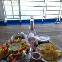 Pre-ordered crudites and dip and Gucamole and corn chips enjoyed on Deck 7