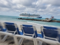 View of anchored ship from beach at Princess Cays.