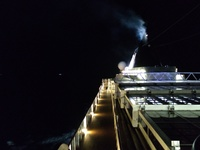 Upper deck at night, passing through the straights of Gibraltar