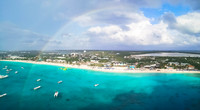 Grand Turk beach from the ship with a rainbow