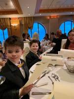 My boys in their tuxes in the main dining room just before the waiter threw