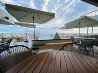 Main outdoor area on Deck 3. Pool, lounge chairs and informal dining room (