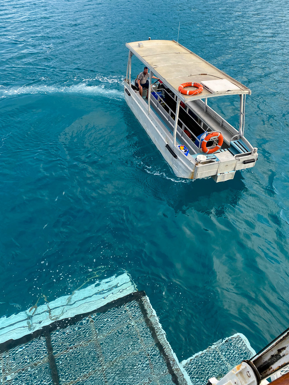 """Glassy"" (Glass bottomed boat) returning to the back deck lift"
