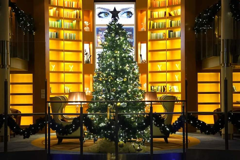 The library of the ship decorated for Christmas.