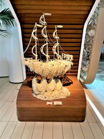 Sailing ship made entirely of pearls.  Once of the many sculptures througho