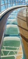 Deck 16 (pool deck) glass bottom walking bridge