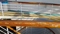 Banisters worn to bare wood throughout the ship